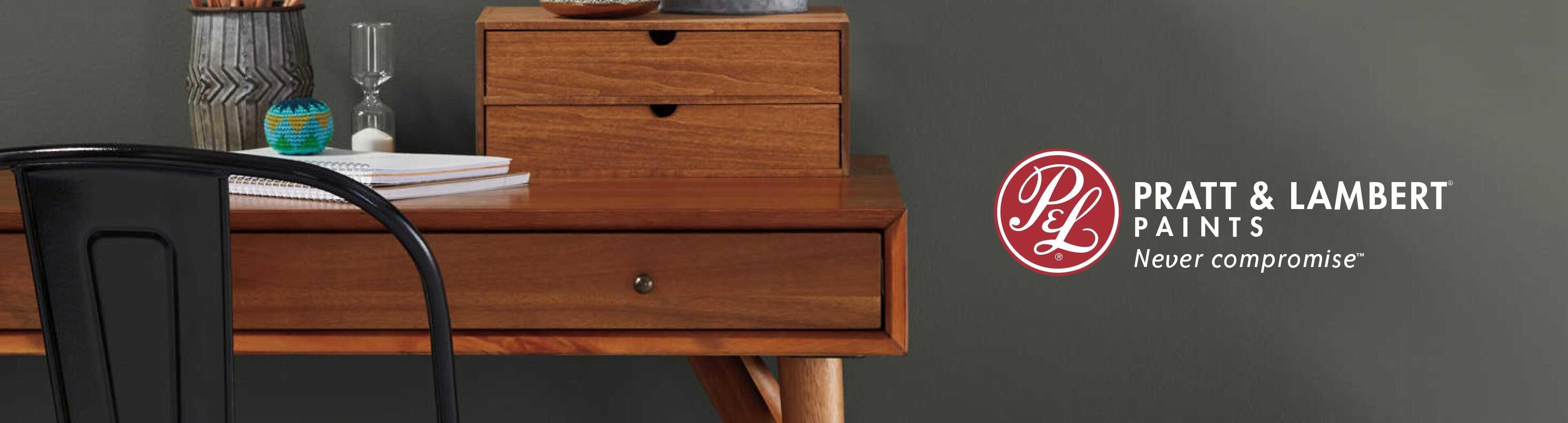 Wooden desk with painted wall and Pratt & Lambert logo