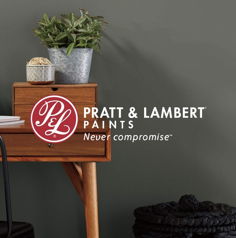 Wooden desk with painted wall and Pratt & Lambert logo